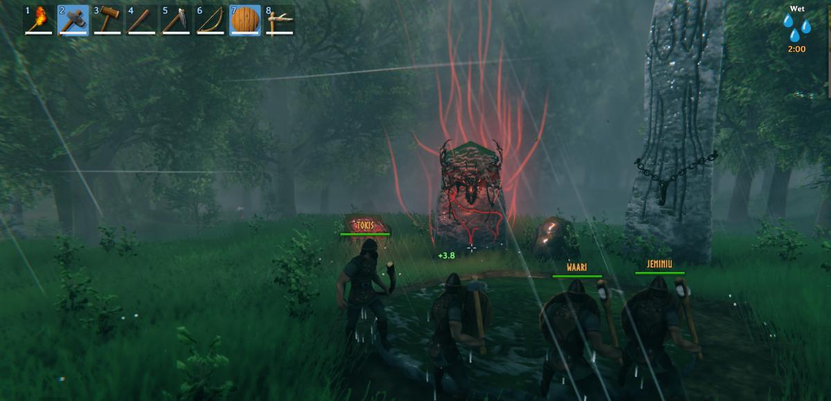 Kuva Valheim- nimisestä pelistä. Kuvassa joukko hahmojen niityllä suuntaamassa kohti lieskoja.